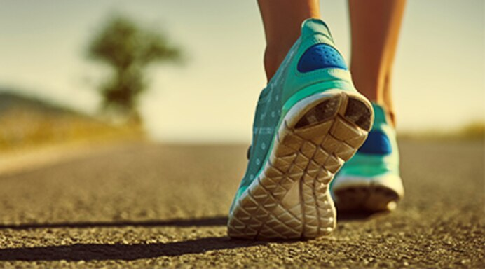 https://img.webmd.com/dtmcms/live/webmd/consumer_assets/site_images/rich_media_quiz/topic/rmq_benefits_of_walking/405rmq_thinkstock_woman_walking_sneakers.jpg?resize=692px:*